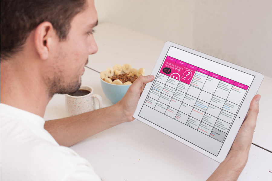 Business owner looking at July 2020 social media planner calendar on iPad Pro