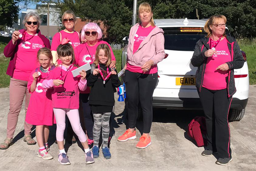 The Cancer Research Walkers with their medals after the event.