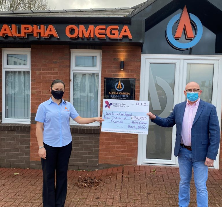 Loren Mumford and Ken Lawton hold the cheque for £5,000 raised by the Alpha Omega Merry Miles fun run for MCH Charity.